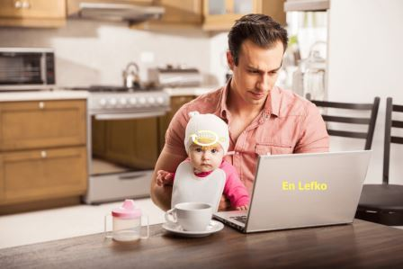 single father with baby working from home